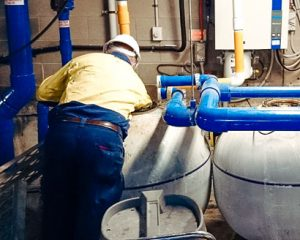 service technician undertaking maintenance in a water park plant room